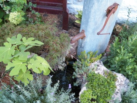Your water feature doesn't need to be a giant.  Even a small fountain can add the sound your ears long for.